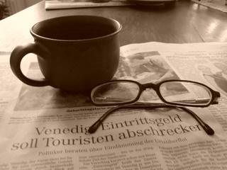 http://ittybiz.com/wp-content/uploads/2007/10/coffee-newspaper-1.jpg