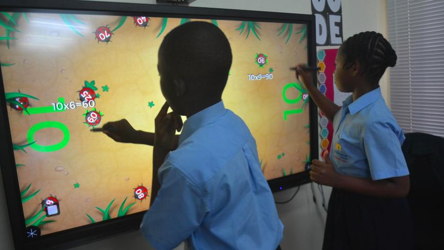 Children using MultiTeach Bugs with WOWbii touchscreen
