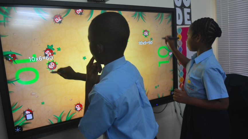 Children using MultiTeach Bugs with WOWbii touchscreen