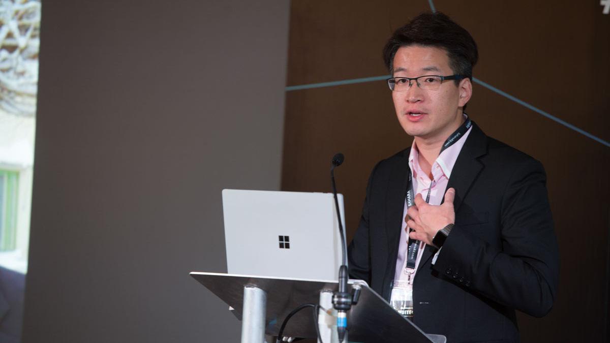 Dr.-Edward-Tse-presenting.png