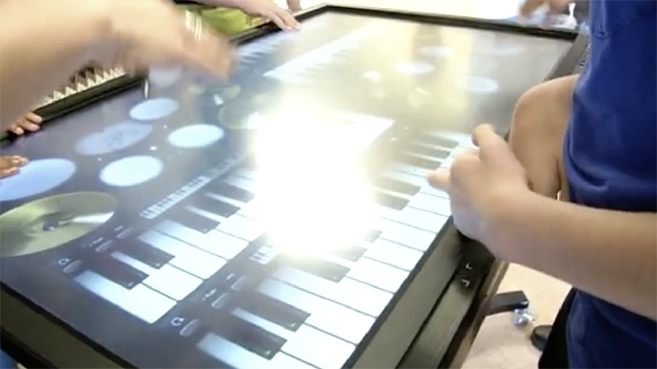 Hands on touch screen.png