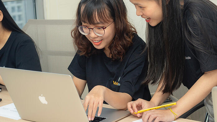 girls in front of computer