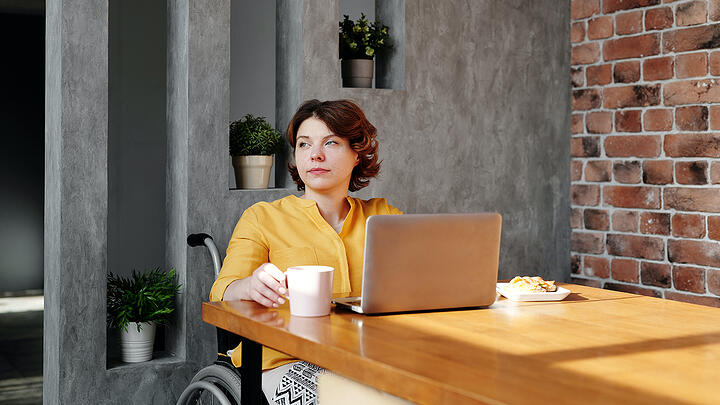 photo-of-woman-sitting-by-the-table-while-looking-away-4064638