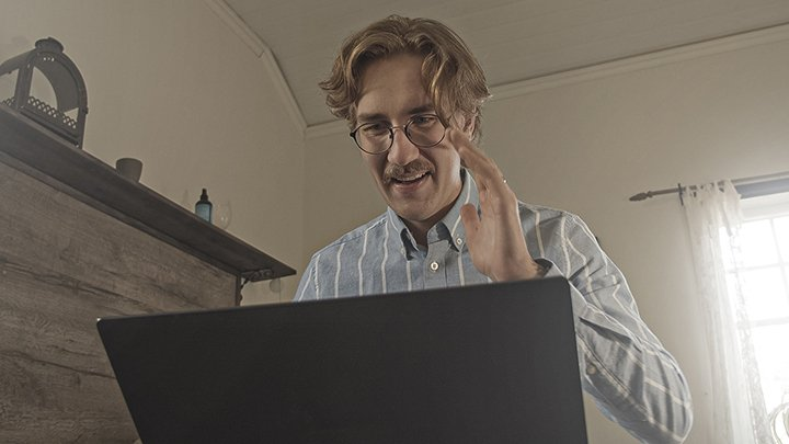 Person_waving_by_computer